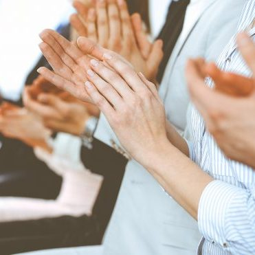 bigstock-Business-People-Clapping-And-A-365381635-768x371